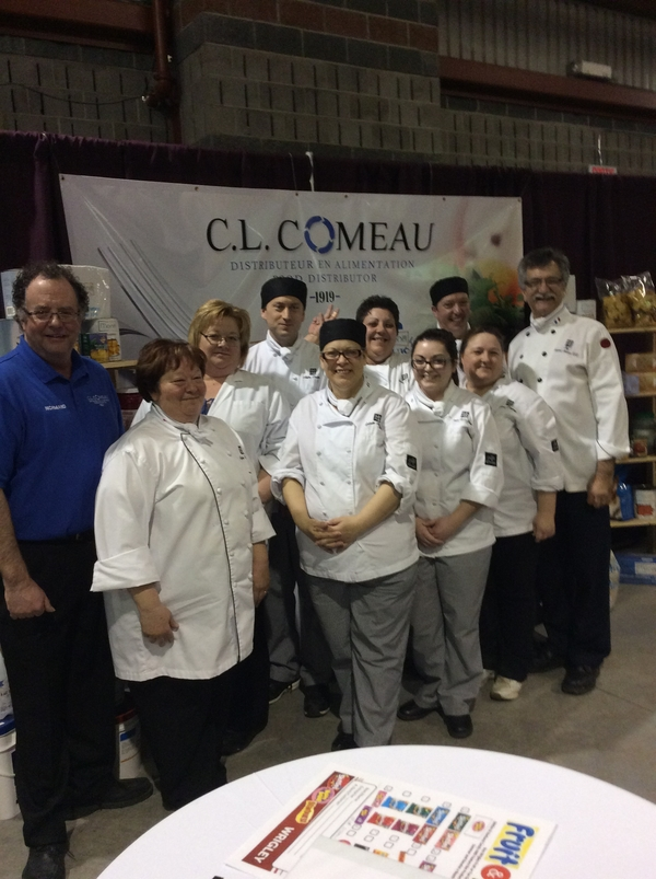 Teacher Mr Richard Chiasson and his cookery students from the CCNB-Acadian Peninsula lend a much-appreciated hand.
